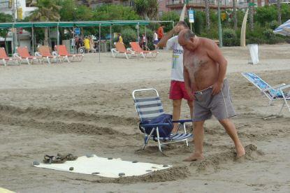 Arte de la toalla en la playa