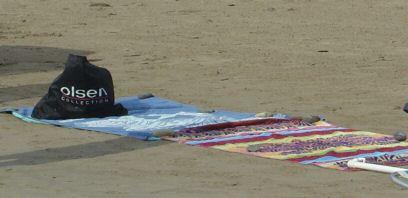 El arte de la toalla en la playa